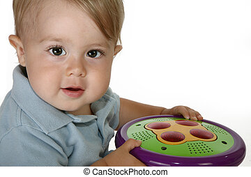 Adorable baby boy on spinning toy