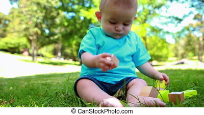 Adorable baby boy playing with buil