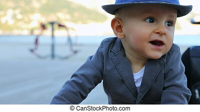 Adorable Baby Boy With Hat And Suit Jacket