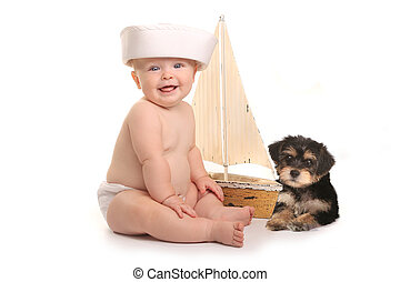 Adorable Baby Boy With His Pet Teacup Yorkie Puppy