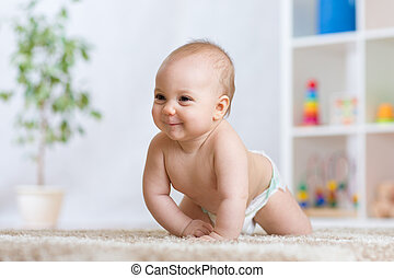 Adorable baby crawling on floor in the nursery