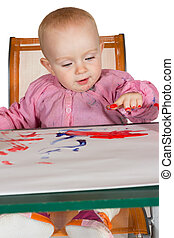 Adorable baby finger painting
