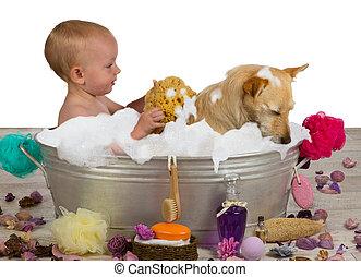 Adorable baby girl bathing with her dog