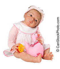 Cute Baby Doll sitting down with Duck and dreaming, isolated on white