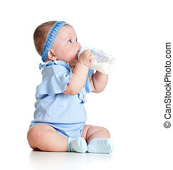 adorable baby girl drinking milk from bottle without help