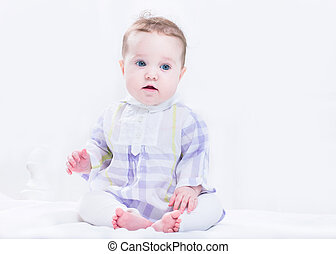 Adorable baby girl in a beautiful purple dress