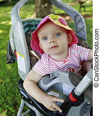 Adorable  baby girl in the stroller