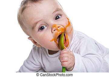 Adorable baby girl making a mess while feeding - An Adorable...