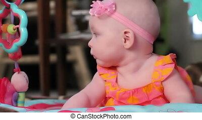 Adorable Baby Girl on Play Mat