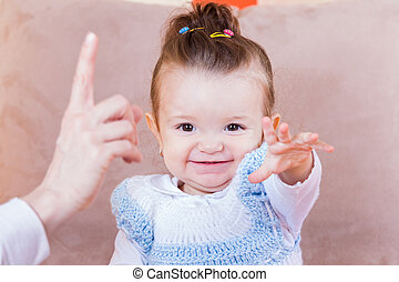 Photo of an adorable cheerful baby girl