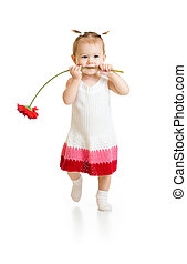 Adorable baby girl walking with flower in mouth isolated