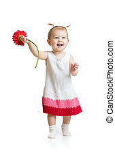 Adorable baby girl walking with flower isolated - Baby girl...
