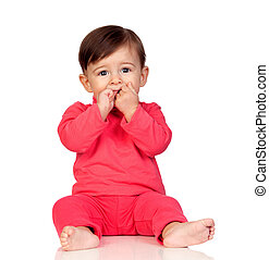 Adorable baby girl with her hand in mouth