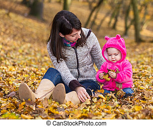 Adorable baby girl with her mother