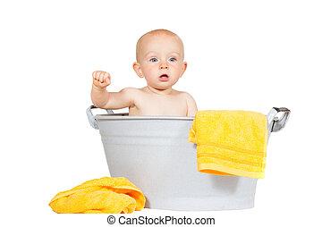 Adorable baby in a zinc bath