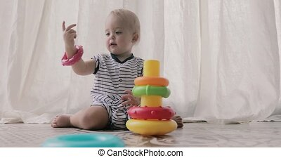 Adorable baby playing with toys