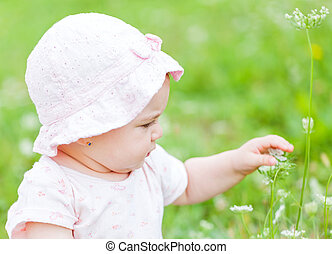 Adorable baby - Portrait of an adorable baby girl in outside