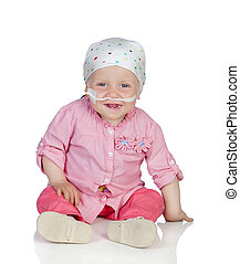 Adorable baby with a headscarf beating the disease isolated...