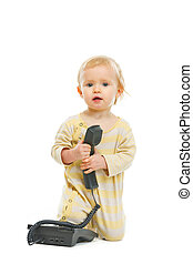Adorable baby with phone handset isolated on white
