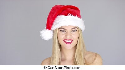 Adorable beautiful girl posing isolated in Santa Claus Hat