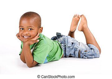 Adorable black boy laying down