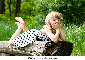 adorable blond girl in meadow