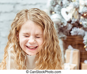 Adorable blond little girl with closed eyes