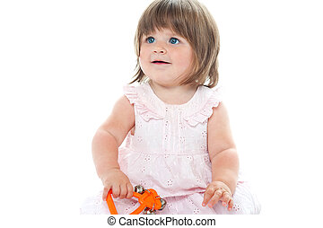 Adorable blonde infant playing with a rattle