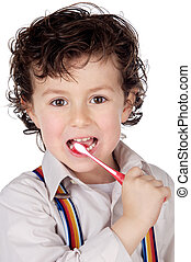 adorable boy child cleaning the teeth a over white...