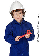 Adorable boy dressed worker in a hammer and a helmet
