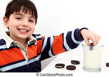 Adorable Boy Dunking Cookies in Milk