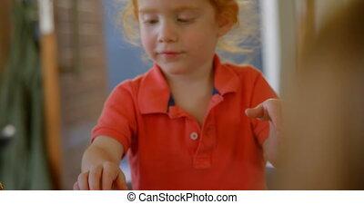 Adorable boy having sweet food at home 4k - Adorable boy ...
