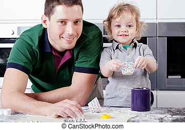 Adorable boy helps his dad
