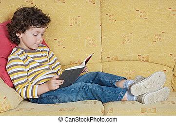 adorable boy reading