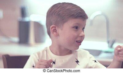 Adorable Boy Showing Finger Something Useful - Close-up Of...