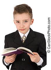 adorable boy with a book