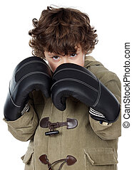 adorable boy with boxing gloves