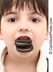 Adorable Boy with Mouth Full of Cream Stuffed Cookies