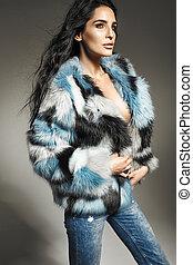 Adorable brunette girl wearing fur coat