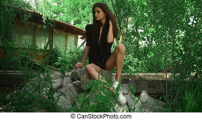 adorable brunette lady in provocative stylish clothes sits...
