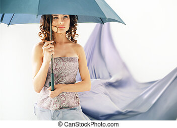 Adorable brunette woman holding an umbrella