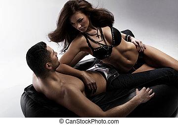 Adorable brunette woman tempting her boyfriend