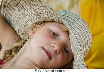 blond girl in hat