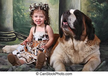 Adorable Child and Her Saint Bernard Puppy Dog - Child and...