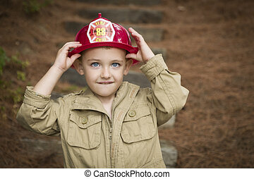 Adorable Child Boy with Fireman Hat Playing Outside