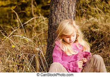 adorable child in autumn forest smiling