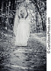 adorable child in long white wedding dress