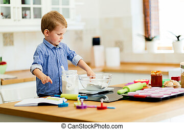 Adorable child making cookies