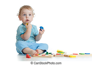Adorable child playing educational toys isolated on white