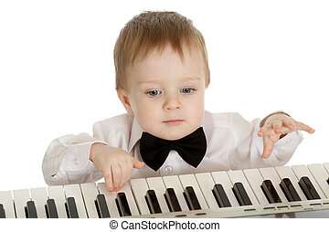 adorable child playing electronic piano